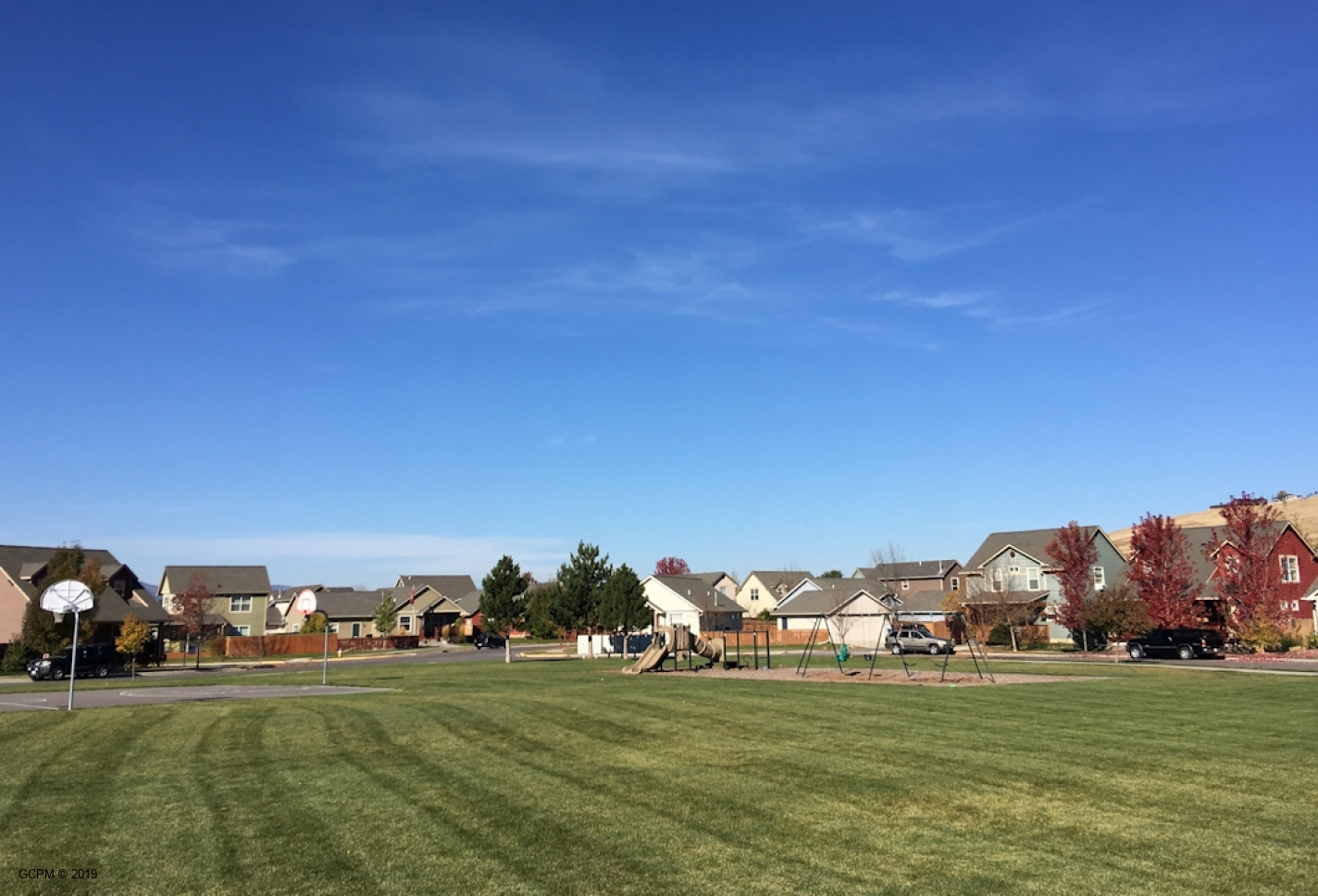 Close to a park with playground, basketball hoops and large field.
